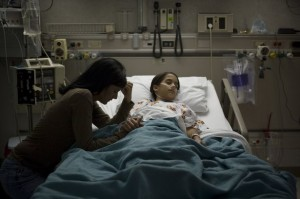 High-angle-view-of-a-girl-lying-on-a-hospital-bed-3146853